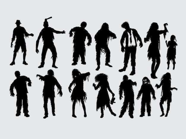 Silhouette d'action masculine et féminine zombie