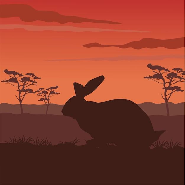 Silhouette d'animal mignon lapin sauvage avec scène de paysage