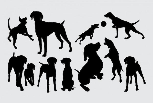 Silhouette de chien jouant