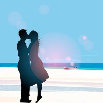 Silhouette d'un couple amoureux s'embrassant contre une plage