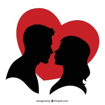Silhouette d'un couple et d'un coeur rouge