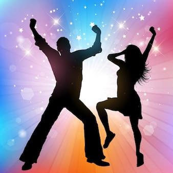 Silhouette d'un couple qui danse sur un fond starburst