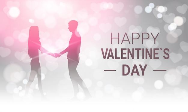 Silhouette couple tenant par la main sur la conception de carte de voeux scintillante happy valentines day