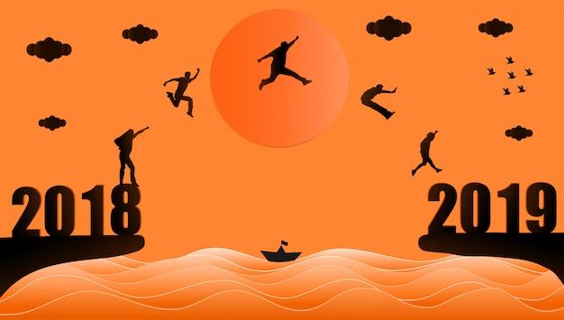 Silhouette d'un groupe de personnes sautant de l'année 2018