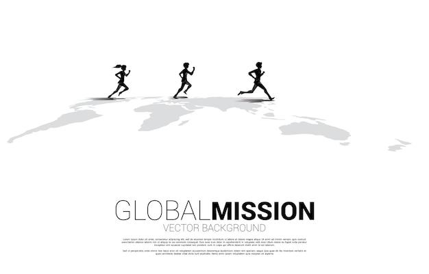 Silhouette d'homme d'affaires et femme d'affaires s'exécutant sur la carte du monde. concept d'entreprise de la mission cible mondiale.