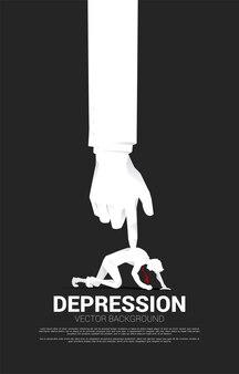 Silhouette d'homme d'affaires sur le genou avec une grosse main sur le dos. concept pour le stress au travail et déprime les gens.