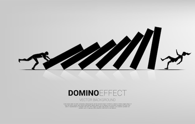 Silhouette d'homme d'affaires poussant à l'effondrement de domino à la femme d'affaires tombant. concept d'entreprise de perturbation commerciale et effet domino