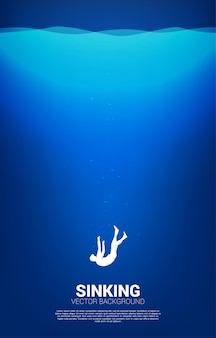 Silhouette d'homme d'affaires s'enfonçant dans l'eau. concept d'échec et d'affaires accidentelles