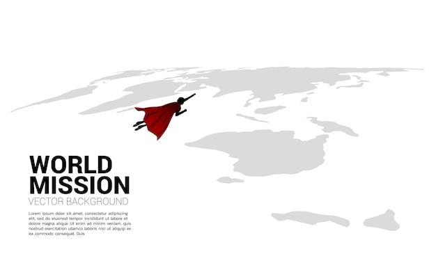 Silhouette d'homme d'affaires survole la carte du monde. concept d'entreprise de la mission cible mondiale.