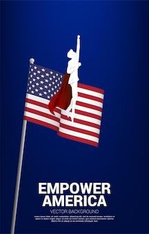 Silhouette d'homme d'affaires volant avec fond drapeau usa. concept d'entreprise pour le démarrage aux états-unis.