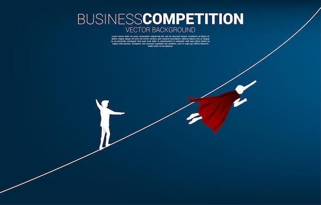 La silhouette d'un homme d'affaires volant rivalise avec l'homme marchant sur une corde. concept de risque d'entreprise et de cheminement de carrière