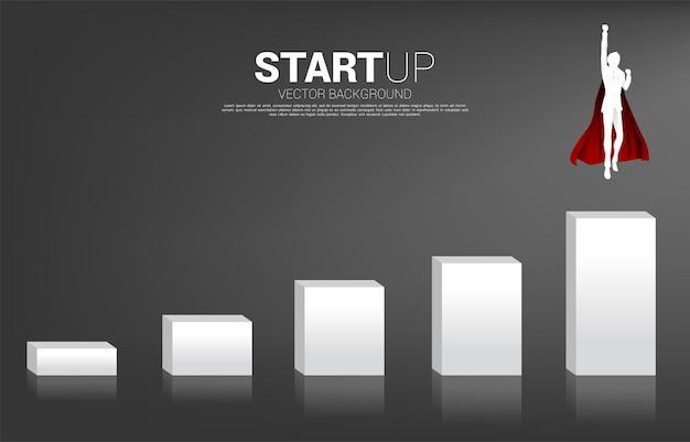 Silhouette d'homme d'affaires volant vers la colonne supérieure du graphique. concept de coup de pouce et de croissance dans les affaires.