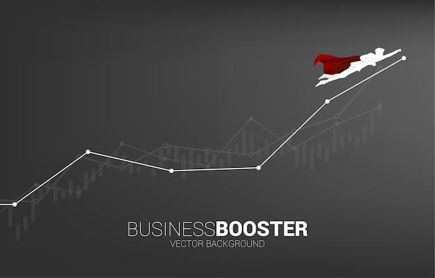 Silhouette d'homme d'affaires volant vers un graphique linéaire supérieur. concept de coup de pouce et de croissance dans les affaires.