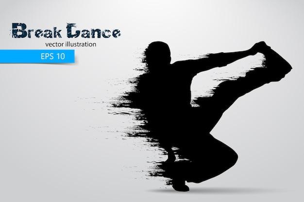 Silhouette d'un homme break dancer