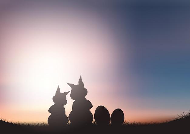 Silhouette de lapins de pâques contre un ciel coucher de soleil