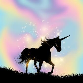 Silhouette d'une licorne sur un fond dégradé hologramme
