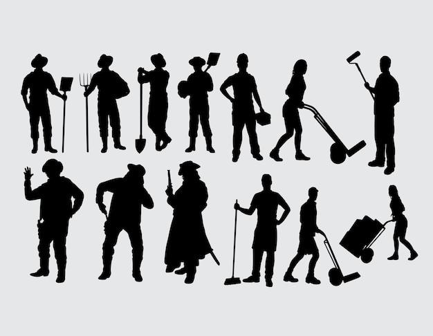 Silhouette masculine et féminine d'activité de travailleur