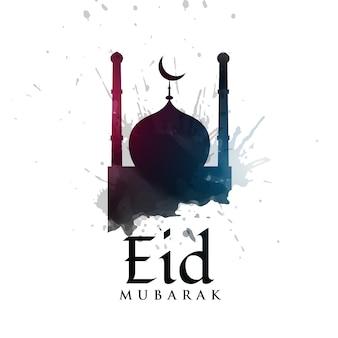 Silhouette de la mosquée avec des éclaboussures d'encre pour le festival eid