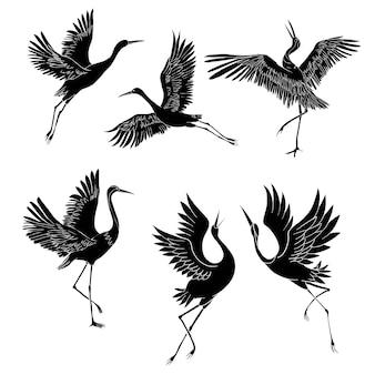 Silhouette ou ombre des icônes d'encre noire d'oiseaux de grue ou de hérons volant et debout.