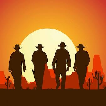 Silhouette de quatre cow-boys marchant vers la bannière,