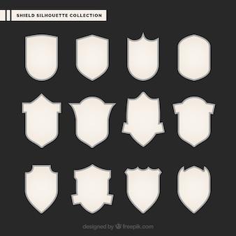 Silhouettes de boucliers blancs