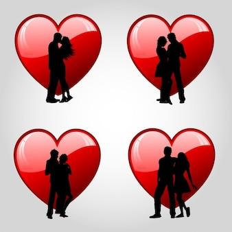 Silhouettes de couples contre coeurs rouges brillants
