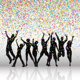 Silhouettes de gens qui dansent sur un fond coloré confetti