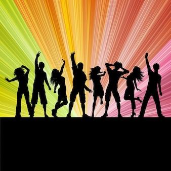 Silhouettes de gens qui dansent sur un fond starburst