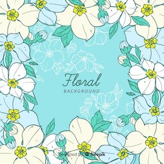 Silhouettes à la main fond floral dessiné