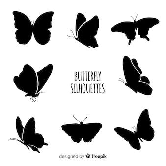 Silhouettes de papillons volants
