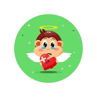 Singe ange mignon est triste tenant l'amour