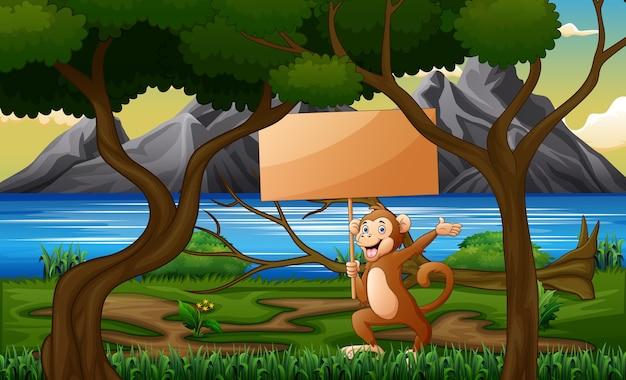 Singe de dessin animé tenant une pancarte en bois dans la forêt