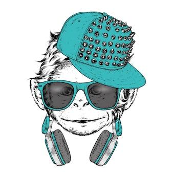 Singe drôle portant casquette et lunettes