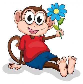 Un singe avec une fleur bleue