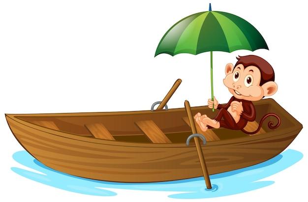 Singe mignon aviron bateau en bois sur fond blanc