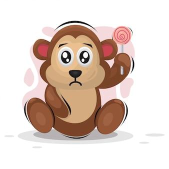 Singe mignon avec dessin animé mascotte bonbon