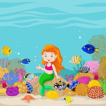 Sirène mignon présentant dans le fond sous-marin
