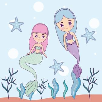 Sirènes mignonnes dans la mer