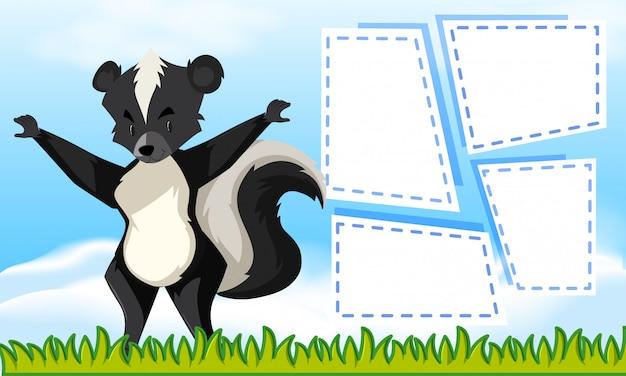 Un skunk sur des cadres de notes vierges