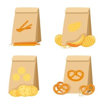 Snack salé dans des sacs en papier, bretzel, cracker, pailles, chips. un ensemble de collations sèches dans l'emballage.