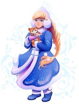 Snow maiden snegurochka tient un petit tigre dans ses mains, symbole de 2022