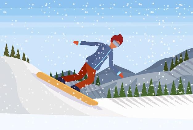 Snowboarder homme glissant sur la montagne