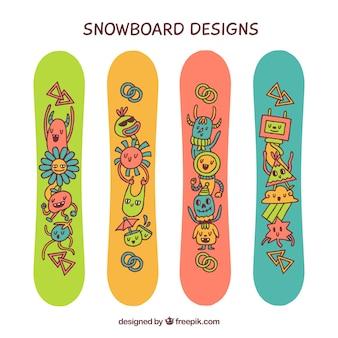 Snowboards drôles avec des personnages dessinés à la main