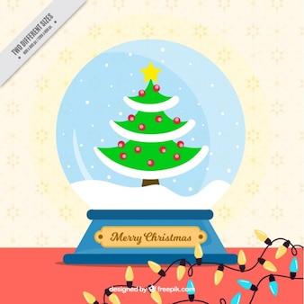 Snowglobe fond avec arbre de noël dans le design plat