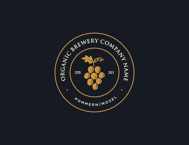 Société de logo de brassage de raisin