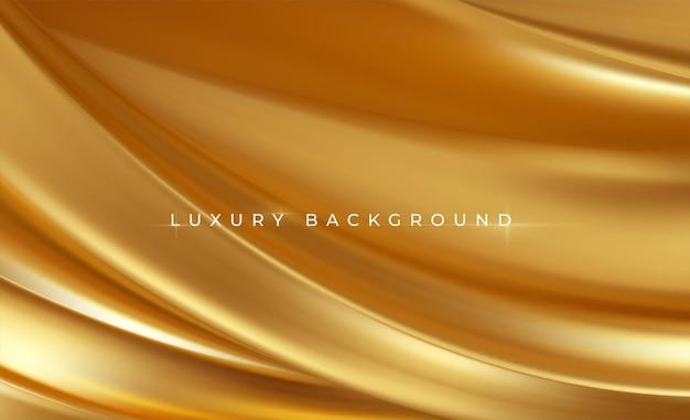 Soie métallisée or fluide vague luxe tendance.