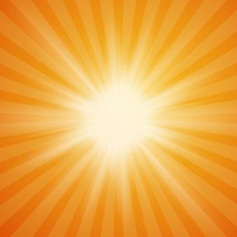 Le soleil d'été éclate sur fond orange avec des rayons lumineux.