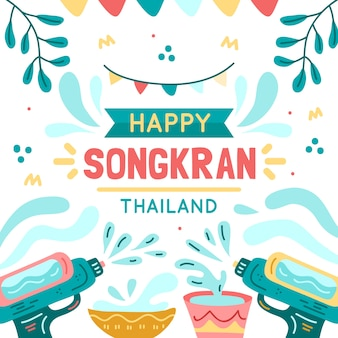 Songkran heureux avec des pistolets à eau