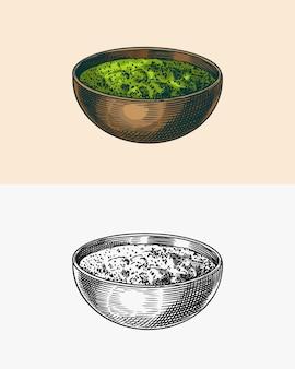 Soupe au basilic sauce pesto dans le bol croquis dessiné à la main gravé