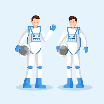 Souriant équipe d'astronautes, deux hommes en combinaison spatiale agitant la main et tenant des casques